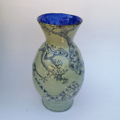 Green vase with blue interior