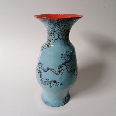 Blue vase with orange interior