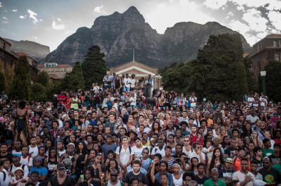 Student watching the removal of Cecil John Rhodes Statue at University of Cape Town