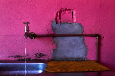 Pink Tap in a hostel in Langa Township
